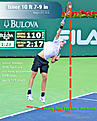 Isner at impact on first serve, JF photo from Indian Wells